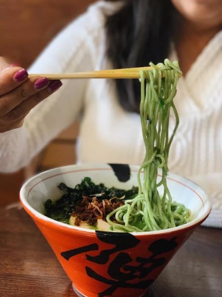 close up of woman eating ramen